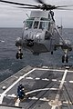 U.S. Sailors aboard the guided missile frigate USS Ford (FFG 54) retrieve a delivery from a Royal Canadian Navy CH-124 Sea King helicopter during Exercise Trident Fury 2013 May 13, 2013, while underway in 130513-N-QY316-053.jpg