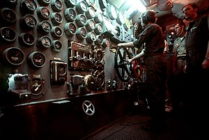 Iowa-class battleship - A crewman operates the ship's throttle in the main engine room aboard New Jersey.