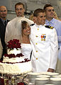 US Navy 030501-N-8590B-003 Lieutenant David Kozminski, a Naval Aviator assigned to Sea Control Squadron Thirty Five (VS-35) and his bride prepare to cut their wedding cake.jpg