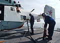 US Navy 030615-N-4374S-013 Flight deck crewmembers assigned to the Aegis cruiser USS Vella Gulf (CG 72) refuel the Russian K-27 Helix.jpg