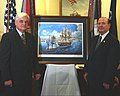 US Navy 030616-N-2568S-001 Award-winning artist Tom W. Freeman presents his painting Payment in Iron to the Honorable Hansford T. Johnson, Acting Secretary of the Navy (SECNAV).jpg