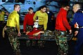 US Navy 030722-N-5555F-025 Stretcher Bearers carry a wounded Sailor through the hangar bay of the aircraft carrier USS Carl Vinson (CVN 70) during a Mass Casualty Drill.jpg