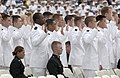 US Navy 040528-N-9693M-013 Midshipmen stand during the administration of Oath of Office for graduates entering service as a Navy Ensigns during the U.S. Naval Academy class of 2004 graduation.jpg
