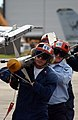 US Navy 041203-N-6842R-061 Aviation Ordnancemen remove an AIM-9M Sidewinder missile from an F-A-18A- Hornet.jpg