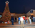 US Navy 041206-N-9563N-005 Sailors assigned to Naval Support Activity (NSA) Bahrain celebrate the holiday season by lighting the base Christmas tree and singing Christmas carols.jpg