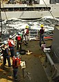 US Navy 050105-N-6074Y-061 Sailors of the Merchant Marine aboard USNS Rainier (T-AOE 7) prepare to receive the fuel transfer line from the USNS Tippecanoe (T-AO 199) as she comes alongside for replenishment.jpg