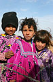 US Navy 050124-N-1810F-466 Local Iraqi children pose for a picture as they stand outside the barbed-wire barricades set up by Seabees prior starting work.jpg