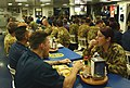 US Navy 050616-N-8146B-001 Australian service members and U.S. Navy culinary specialists stationed aboard the amphibious assault ship team up to provide a traditional Australian meal.jpg