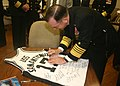 US Navy 060114-N-0191T-033 Chief of Naval Operations, Admiral Mike Mullen signs a basketball jersey for the crew of USS San Antonio (LPD 17).jpg