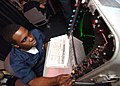 US Navy 060214-N-9915J-002 Operations Specialist Seaman Recruit Najiyb Gibbons, integrates a SPA 25G radar system, which identifies surface contacts using in the tactical plotting room of the bridge aboard the nuclear-powered a.jpg