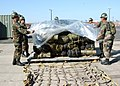 US Navy 061027-N-3560G-008 Members of Naval Mobile Construction Battalion Four (NMCB-4) load field gear onto a pallet. NMCB-4 is homeported at Ventura Naval Base, Port Hueneme, Calif.jpg
