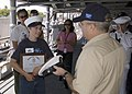 US Navy 070320-N-6775N-171 Neil Smith is presented with Master Chief Operations Specialist Gary Horton's personal, 18-year-old combination cover at the end of his tour on board guided missile cruiser USS Lake Erie (CG 70).jpg