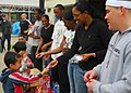 US Navy 070421-N-4124C-066 Sasebo-based Forward Deployed Naval Forces (FDNF) Sailors hand out chocolate at the conclusion of a visit to the foster care facility Koyoryo Children's Home.jpg