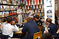 US Navy 070507-N-0318S-017 Executive Officer Lt. Cmdr. Jeff Oakey and Repair Officer Ensign Laura Le from USS Mesa Verde (LPD 19) talk with sophomore and junior students at Gateway High School, Aurora, Colo., about Navy Reserve.jpg