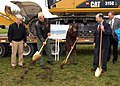 US Navy 071031-N-9860Y-005 Leaders from Naval Air Station Whidbey Island, the Oak Harbor community, and the Boeing Company use ceremonial gold shovels to dig the first holes for a groundbreaking ceremony for the Growler Support.jpg