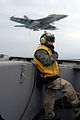 US Navy 080220-N-6326B-058 Lt. Sandra Kosloski supervises the safe recovery of a F-A-18F Super Hornet, assigned to the.jpg