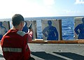 US Navy 080925-N-8593M-022 A Sailor participates in a weapons qualification.jpg