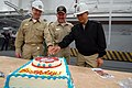 US Navy 081126-N-8772M-063 Lt. Cmdr. Dean Hoelz, Capt. Daniel H. Fillion, and Chaplain Fulgencio Legaspi cut a ceremonial cake honoring the 233rd birthday of the U.S. Navy Chaplain Corps.jpg
