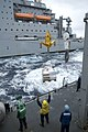 US Navy 090304-N-9123L-003 Sailors aboard the guided-missile destroyer USS John S. McCain (DDG 56) receive a pallet of supplies from the Military Sealift Command Dry Cargo-Ammunition ship USNS Alan Shepard (T-AKE 3).jpg