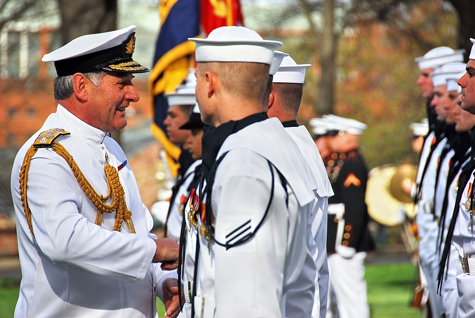 US Navy 090413-N-8732C-036 dm. Sir Jonathon Band, GCB, ADC, First Sea Lord and Chief of Naval Staff of the Royal Navy, left, speaks with a Sailor from the U.S. Navy Ceremonial Guard at the Washington Navy Yard