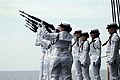 US Navy 090609-N-4995K-066 Members of the aircraft carrier USS Ronald Reagan (CVN 76) honor guard present a rifle salute during a burial at sea ceremony.jpg