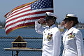 US Navy 090711-N-3005A-017 Chief Mass Communication Specialist Robert Palomares and Capt. Jill Votaw salute the colors during a retirement ceremony aboard the USS Midway Museum.jpg