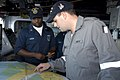 US Navy 090721-N-9123L-010 Quartermaster 1st Class Jory Mason of Chicago, Ill. and Royal Australian Navy Seaman Andrew Smith of guided-missile frigate HMAS Newcastle (FFG 06) review a chart aboard guided-missile destroyer USS M.jpg