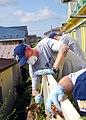 US Navy 090813-N-5387K-011 Chief Boatswain's Mate (sel) Christopher Danula cleans a fence at the Himawari Baby Orphanage in Misawa, Japan.jpg