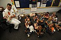 US Navy 090827-N-1928O-028 Yeoman 1st Class Philip Deason reads to kindergarten students at Berther Barber Elementary School as part of outreach efforts sponsored by U.S Strategic Command.jpg