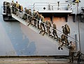 US Navy 100115-N-5345W-090 Marines assigned to the 22nd Marine Expeditionary Unit (22nd MEU) embark aboard the multi-purpose amphibious assault ship USS Bataan (LHD 5) during preparations by the Bataan Amphibious Relief Mission.jpg