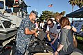 US Navy 100803-N-8951S-004 Master-at-Arms 2nd Class Joseph Mosich, from Naval Weapons Station Seal Beach, shows body armor to residents during the National Night Out program.jpg