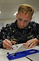 US Navy 100818-N-2259P-054 Ensign Dan Parobek, assigned to the guided-missile destroyer USS Howard (DDG 83) participates in the maneuvering board (MOBOARD) competition during the 2010 Surface Line Week.jpg