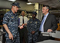 US Navy 101108-N-1947A-014 Deputy Assistant Secretary of the Navy for Energy Thomas Hicks speaks with Capt. Jim Landers, commanding officer of the.jpg