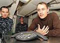US Navy 101229-N-7095C-020 Aviation Structural Mechanic Airman Apprentice Robert Lamont asks Boston Bruins goalie Tim Thomas a question about the N.jpg