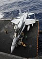 US Navy 110302-N-SG869-198 Sailors assigned to the air department of the aircraft carrier USS Ronald Reagan (CVN 76) move an F-A-18C Hornet assigne.jpg