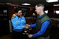 US Navy 110408-N-IC111-934 Capt. Thom Burke, commanding officer of the aircraft carrier USS Ronald Reagan (CVN 76), exchanges a gift with Indian na.jpg