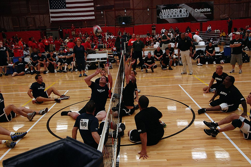 US Navy 110517-N-CD297-109 Members from Team Navy-Coast Guard volley against members of the U.S. Army sitting volleyball team during a preliminary
