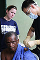 US Navy 110609-N-EP471-097 Lt. Cmdr. Philip Letada emoves a melanoma from a Colombian patient's shoulder during a Continuing Promise 2011 community.jpg