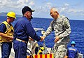 US Navy 110707-N-KB563-041 Capt. S. Robert Roth, left, commanding officer of the amphibious transport dock ship USS Cleveland (LPD 7), welcomes abo.jpg