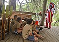 US Navy 110726-N-UA460-053 Cub Scout Master Glynn Wood, right, speaks to a group of Cub Scouts about Native American culture and customs during a C.jpg