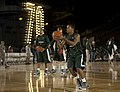US Navy 111110-N-DR144-894 Michigan State University basketball player Keith Applinging practices in the basketball arena on the flight deck aboard.jpg