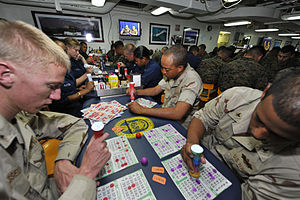 US Navy 111231-N-KS651-426 Marines assigned to the 11th Marine Expeditionary Unit (11th MEU) and Sailors celebrate New Year's Eve by playing bingo.jpg