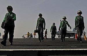 US Navy 120204-N-ZI635-345 Sailors assigned to the Air Department aboard the Nimitz-class aircraft carrier USS Carl Vinson (CVN 70), stow equipment.jpg