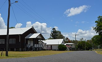 Ubobo - Railway Terrace, 2017. From the left the buildings shown are the Ubobo Memorial Hall, the QCWA rest rooms, the former Station Mistress' house and a private dwelling