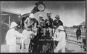 Uganda Railway - Former U.S. President Theodore Roosevelt (seated, at left) and friends mount the observation platform of the Uganda Railway