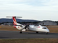 A Qantas Bombardier DHC-8-402Q taxiing to take off from Canberra Airport