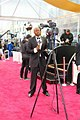 VOA French to Africa broadcaster Rajah Roger Muntu reports from the 2015 Oscars, February 2015.jpg