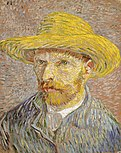 A red-bearded man with a straw hat on gazes to the left.