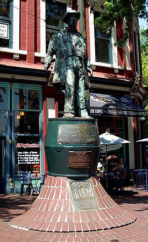 History of Vancouver - The Gassy Jack statue in Gastown.  The mound on which the barrel-pedestal stands is reputed to cover the stump of the original maple tree that stood adjacent to his saloon's porch, and which is the namesake of Maple Tree Square.