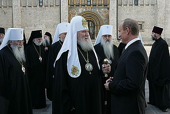 English: Vladimir Putin meets the members of R...